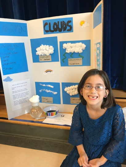 Posing in front of her project.