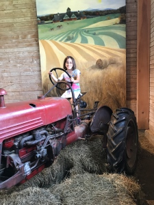 lucia-on-tractor